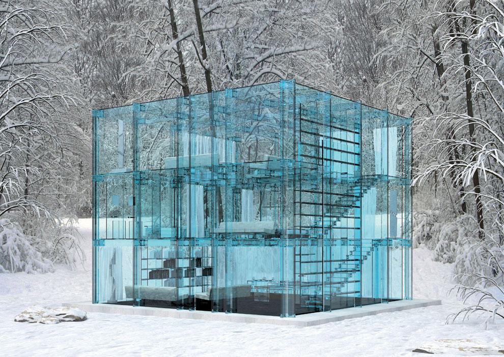 Una casa de cristal en medio de la naturaleza