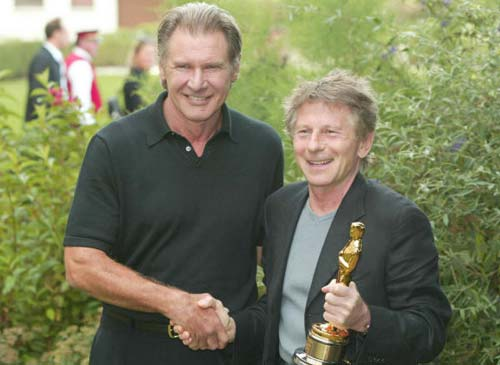 Roman Polanski recibió al fin su Oscar de manos de Harrison Ford