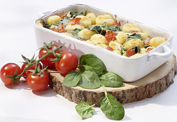 Ñoquis con espinacas y gruyère