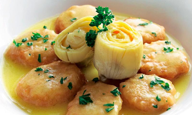 Patatas a la importancia con alcachofas