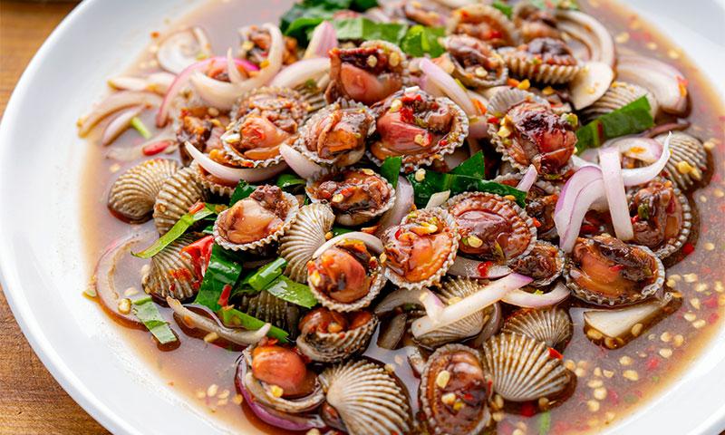 Berberechos marinados con salsa 'thai'