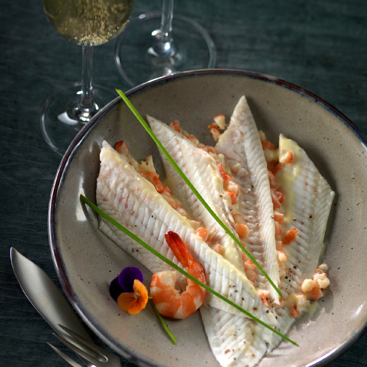 Filetes de lenguado con salsa de champán y gambas
