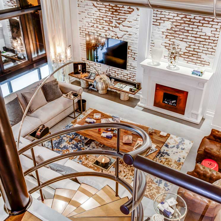 Decoraci n de interiores un 39 loft 39 cosmopolita con una for Decoracion loft industrial