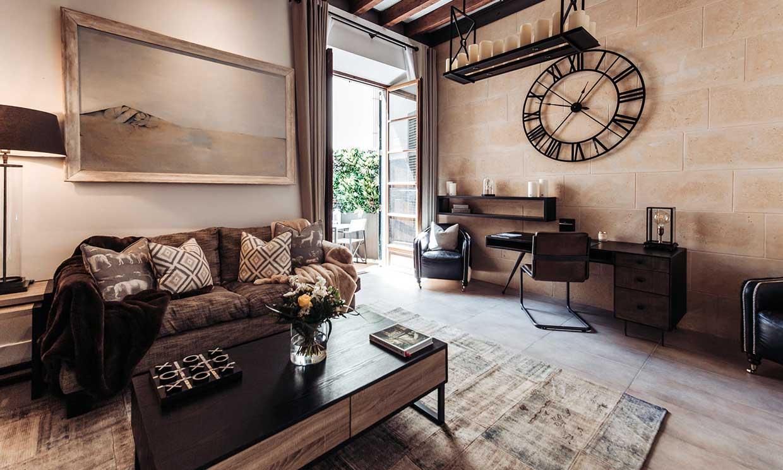 Un apartamento que actualiza el estilo industrial para que luzca moderno y elegante