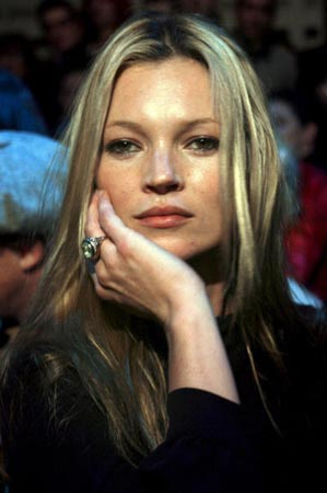 David Beckham y Kate Moss, padrinos del mismo niño