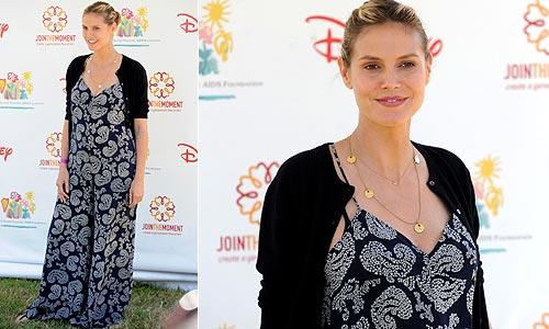 Heidi Klum cambia de estilo, pues no puede ya disimular su cuarto embarazo