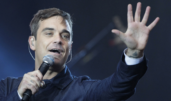 Robbie Williams, enamorado y listo para ser padre, anuncia su regreso junto a Take That