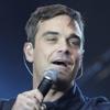 Robbie Williams, enamorado y listo para ser padre, anuncia su regreso junto a Take That