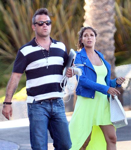 Robbie Williams y Ayda Field, dos futuros papás a la espera