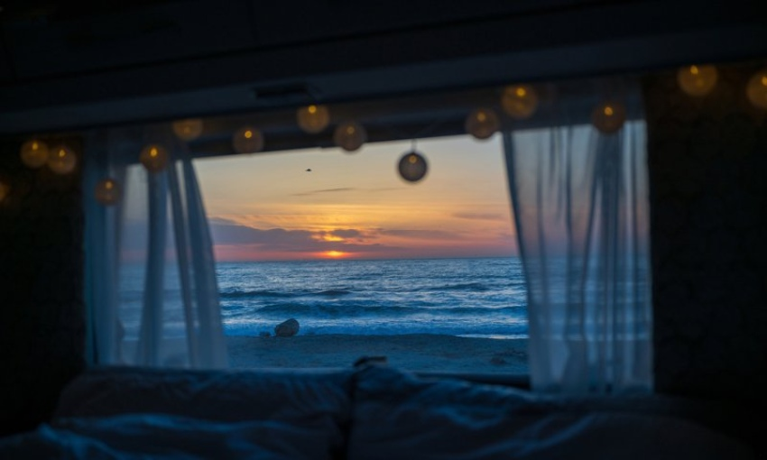 Summer sunset seen from the window of a motorhome.