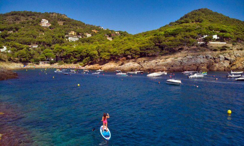 Paddle surf in front of the Aiguafreda cove, near Begur, on the Costa Brava.