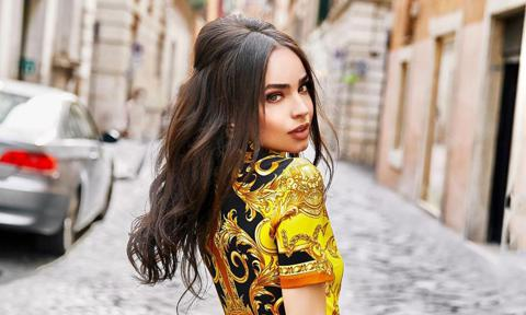 Sofia Carson dressed in Versace while in Rome