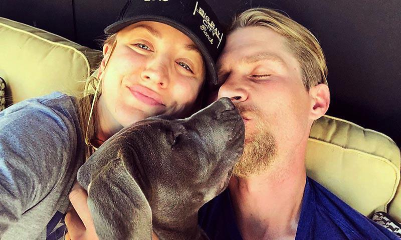 Kaley Cuoco and husband with one of their children