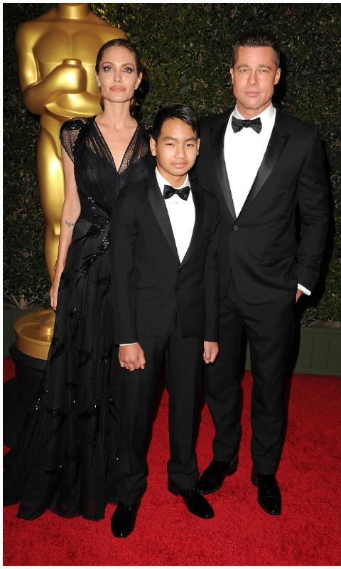 Maddox with Angelina Jolie and Brad Pitt at an awards show