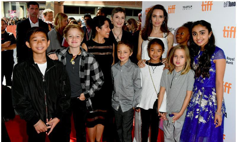 Angelina Jolie posing with four of her kids in Toronto