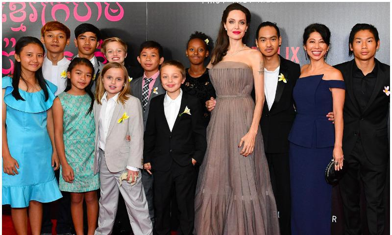 Angelina Jolie posing in the company of her six kids in New York