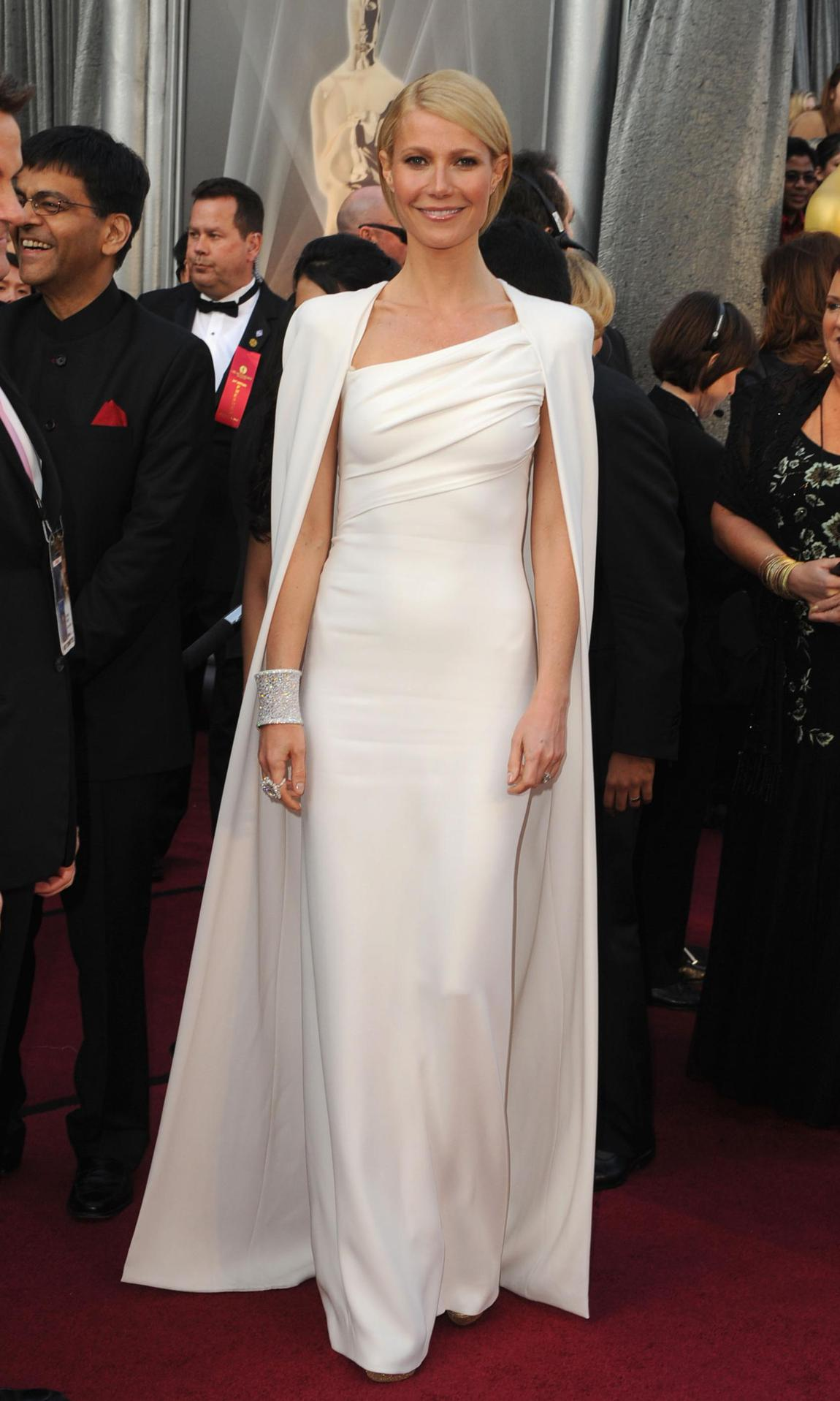Gwyneth Paltrow in a white, caped gown byTom Ford