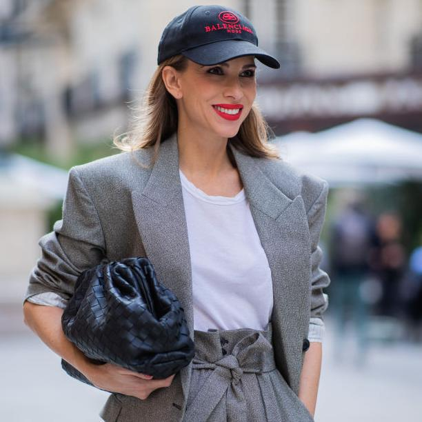Alexandra Lapp wearing Isabel Marant Eladim double-breasted oversized blazer, matching high waist pants from Isabel Marant, flash silver-tone crystal earrings by Isabel Marant, Balenciaga baseball cap and a white James Perse T-Shirt during Paris Fashion Week Womenswear Spring Summer 2020