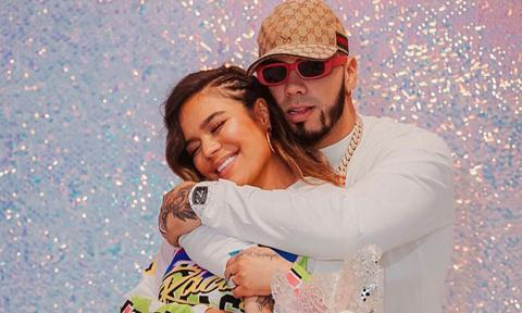 Karol G and Anuel AA posing together at her birthday party