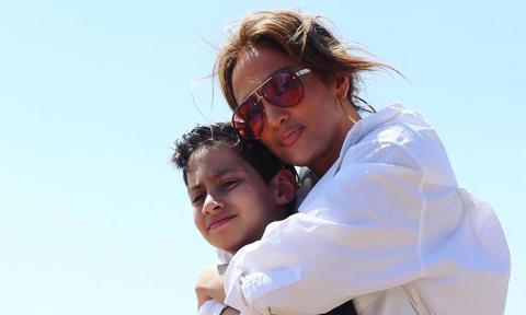 Jennifer Lopez posing with son Max