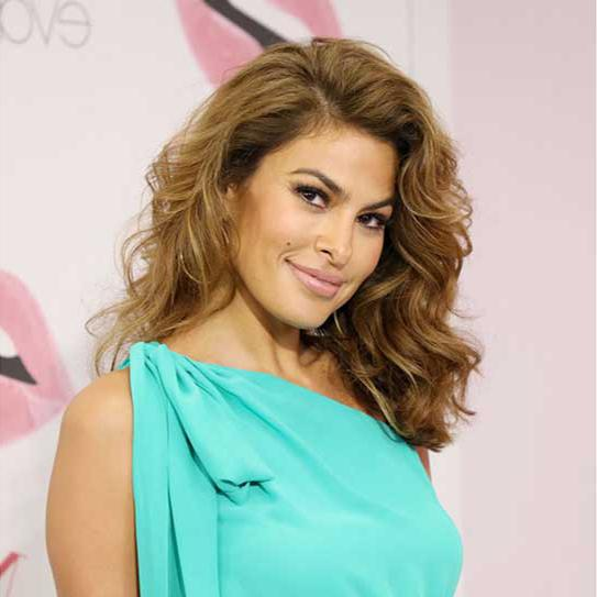 Eva Mendes in a dress with turquoise