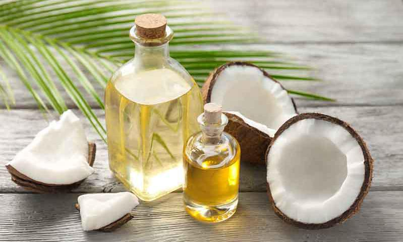 Image of oil and chunks of coconut