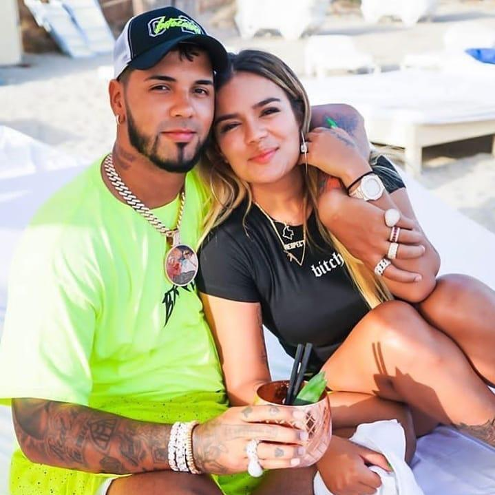 Karol G and Anuel AA posing together