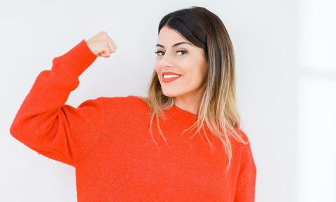 A healthy woman in a red sweater
