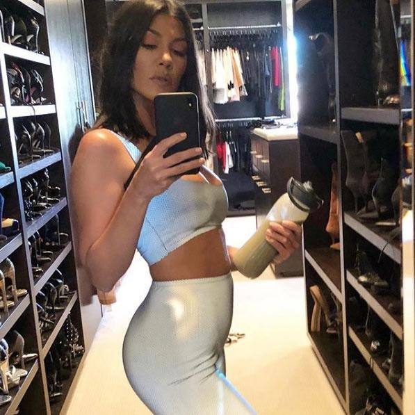 Kourtney Kardashian in her closet