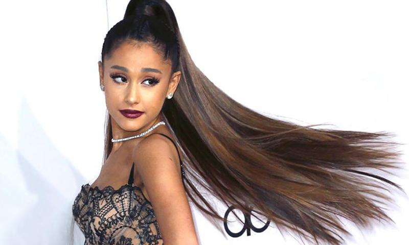 Ariana Grande is unrecognizable as she shows off her natural curls