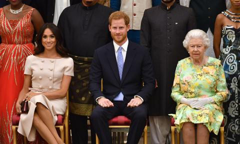 Meghan, Duchess of Sussex, Prince Harry, Duke of Sussex and Queen Elizabeth II at the Queen's Young Leaders Awards Ceremony