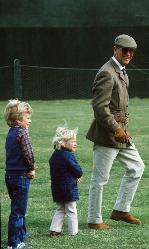 Following the leader! The Queen's husband was dressed to the nines as he strolled the grounds of the 1984 Royal Windsor Horse Show with Peter and Zara Phillips behind him.