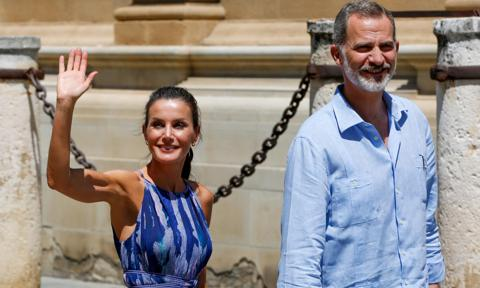 Queen Letizia turned heads in a printed summer dress by Adolfo Dominguez for her trip to Seville