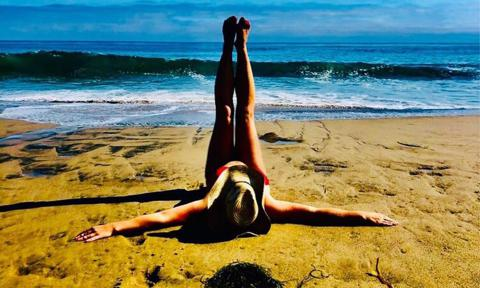 Britney Spears stretching on the beach