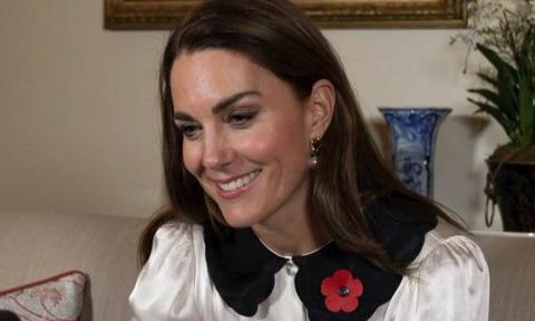 Kate Middleton speaks to military families surrounded by her own family photos