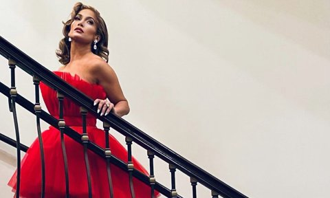 Jennifer Lopez dons a gorgeous red dress for Christmas Eve