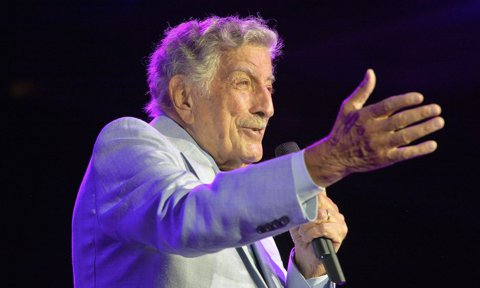 US singer Tony Bennett (Anthony Dominick Benedetto) performs onstage during an invitation-only concert at the newly opened Encore Boston Harbor Casino in Everett, Massachusetts.