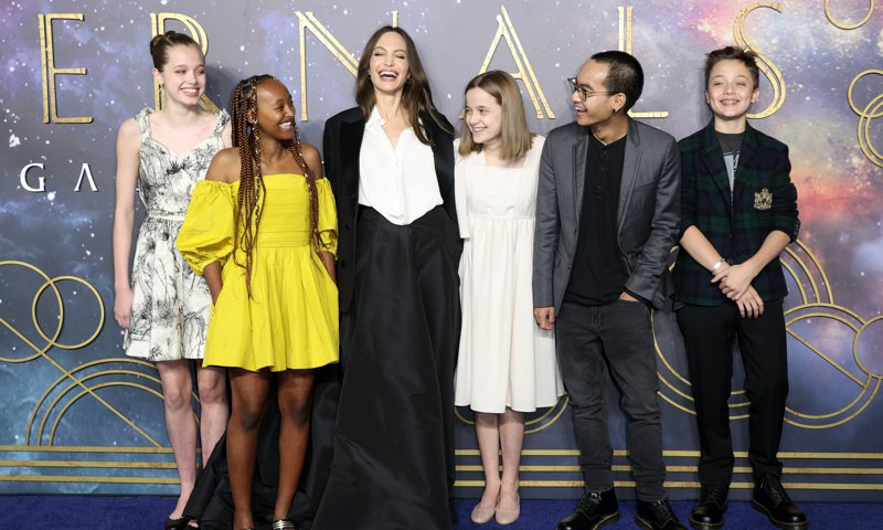 Angelina Jolie and her kids are all smiles as they hit the red carpet together in London